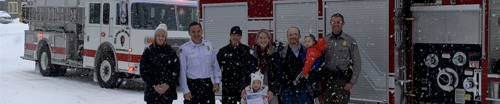 Isabelle Dragoo with her parents, principal. members of Jackson Hole Fire/EMS and Grant Teton National Park