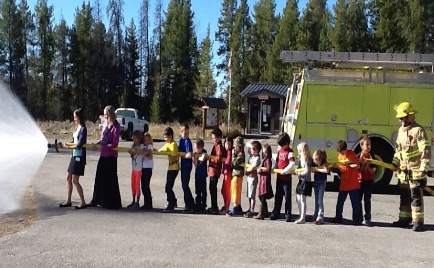 Photo of Moran Students with firemen and water hose
